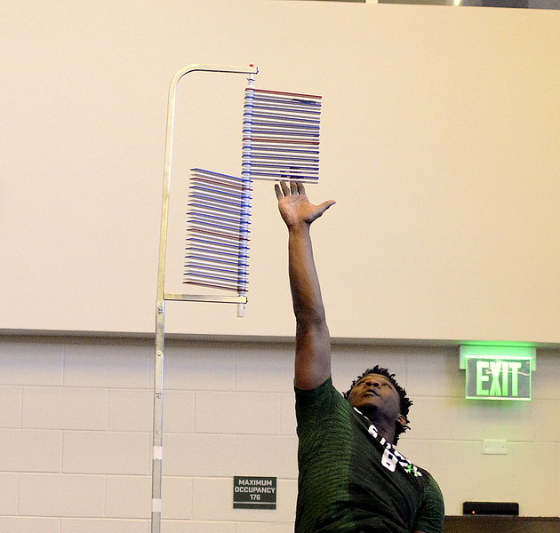 Detrich Clark extends on his second vertical jump during Colorado State's pro day on Wednesday. (Mike Brohard/Reporter-Herald)