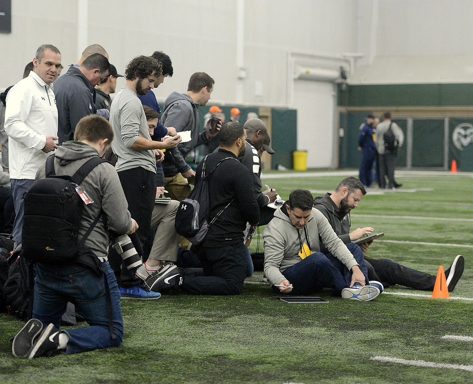Scouts gather at the finish line of the 40-yard dash during Colorado State's pro day on Wednesday. There were representatives from 31 NFL teams and one from the CFL at the workout. (Mike Brohard/Reporter-Herald)