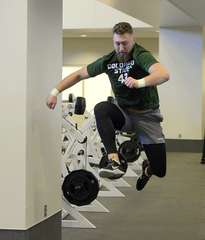. Colorado State\'s Evan Colorito warms up prior to  testing at pro day on Wednesday. (Mike Brohard/Reporter-Herald)