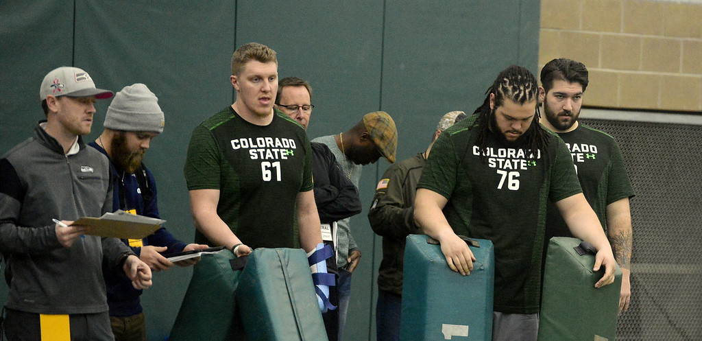 . Offensive linemen Zack Golditch (61), Nick Callender (76) and Trae Moxley wait for their position workouts during Colorado State\'s pro day on Wednesday. (Mike Brohard/Reporter-Herald)