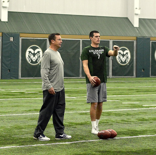 Colorado State quarterback Nick Stevens goes over the plan with former CSU coach and quarterback Steve Fairchild prior to the throwing portion of the team's pro day on Wednesday. Stevens has been working with Fairchild in preparation for the day. (Mike Brohard/Reporter-Herald)