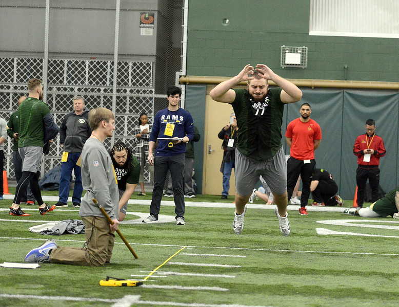 Colorado State center Jake Bennett takes off during the broad jump at the team's pro day on Wednesday. Bennett went 8-feet-1 and ran a 5.4 in the 40-yard dash. (Mike Brohard/Reporter-Herald)