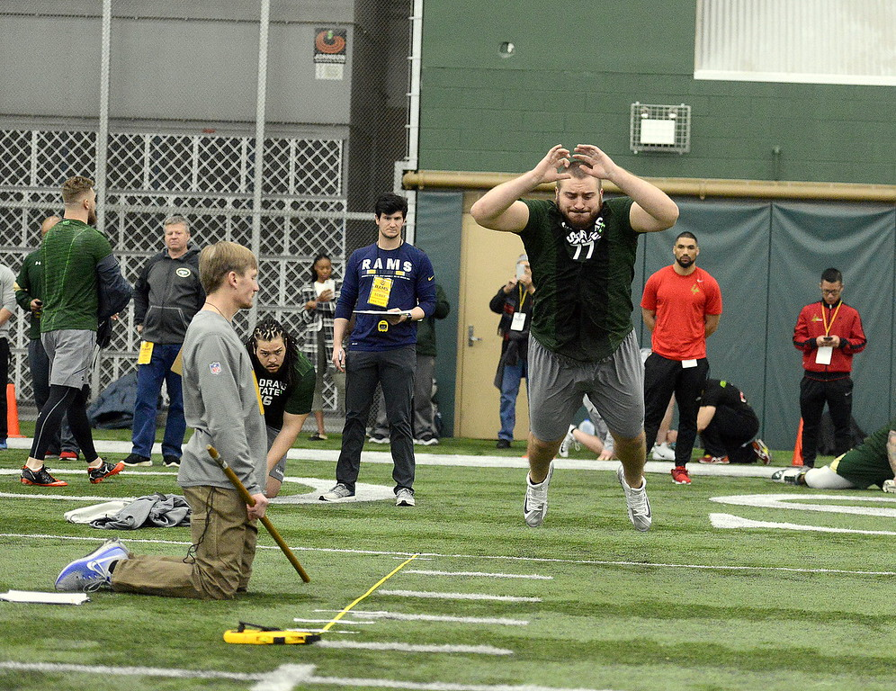 . Colorado State center Jake Bennett takes off during the broad jump at the team\'s pro day on Wednesday. Bennett went 8-feet-1 and ran a 5.4 in the 40-yard dash. (Mike Brohard/Reporter-Herald)