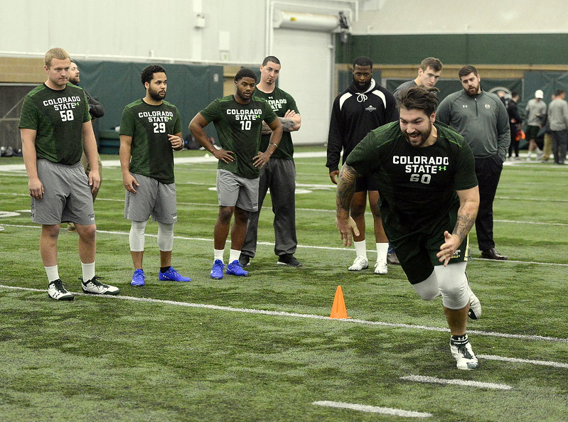 Trae Moxley caps a shuttle drill as his teammates await their turn at Colorado State's pro day on Wednesday. The Rams had 15 players work out on the day for pro scouts. (Mike Brohard/Reporter-Herald)