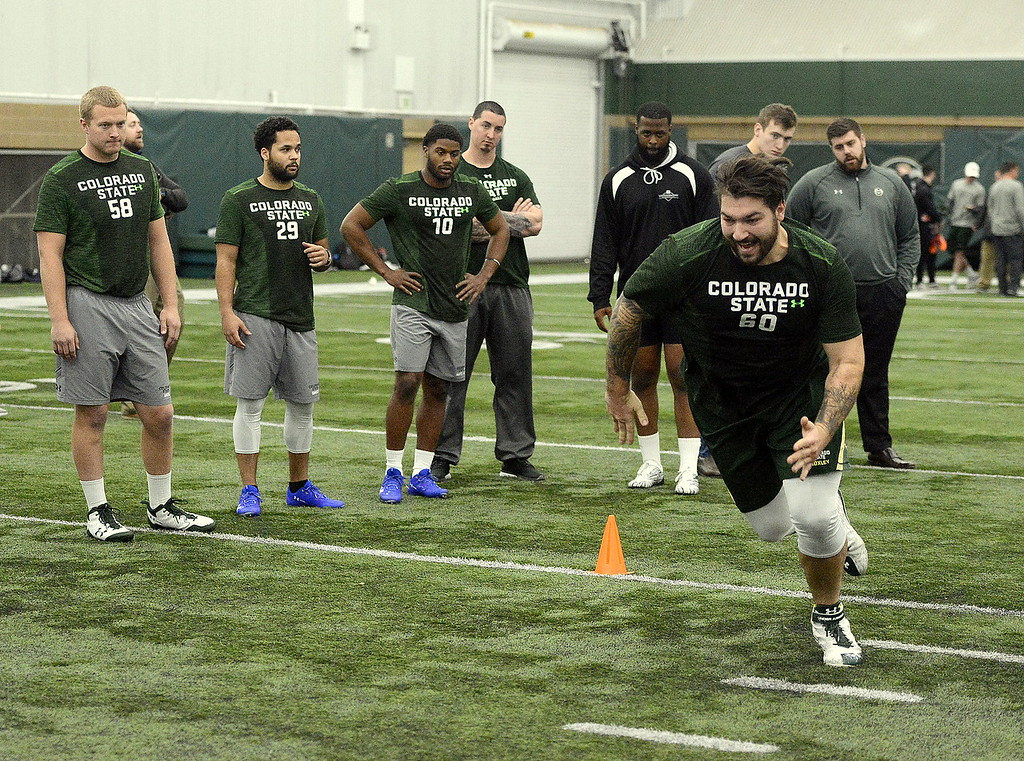 . Trae Moxley caps a shuttle drill as his teammates await their turn at Colorado State\'s pro day on Wednesday. The Rams had 15 players work out on the day for pro scouts. (Mike Brohard/Reporter-Herald)