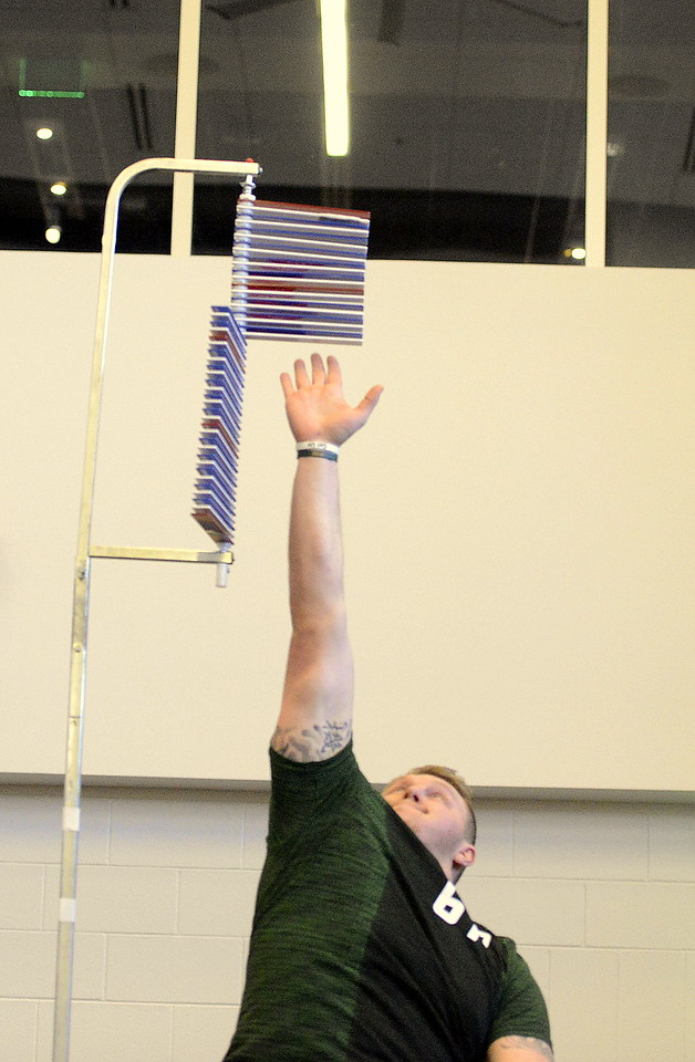 Colorado State tackle Zach Golditch reaches up to touch 32.5 on the vertical leap during Wednesday's pro day. (Mike Brohard/Reporter-Herald)