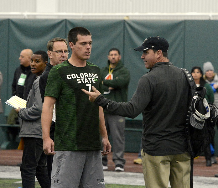 Oakland Raiders scout Dave McCloughan talks to Nick Stevens prior to the skills drills at Colorado State's pro day on Wednesday. (Mike Brohard/Reporter-Herald)
