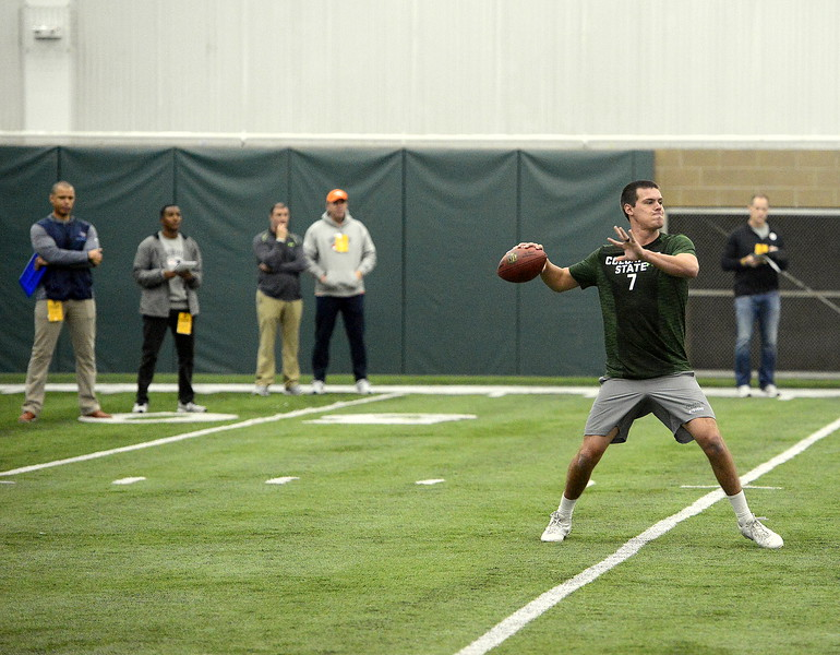 Nick Stevens sets up to deliver a pass as scouts look on during Colorado State's pro day on Wednesday. (Mike Brohard/Reporter-Herald)