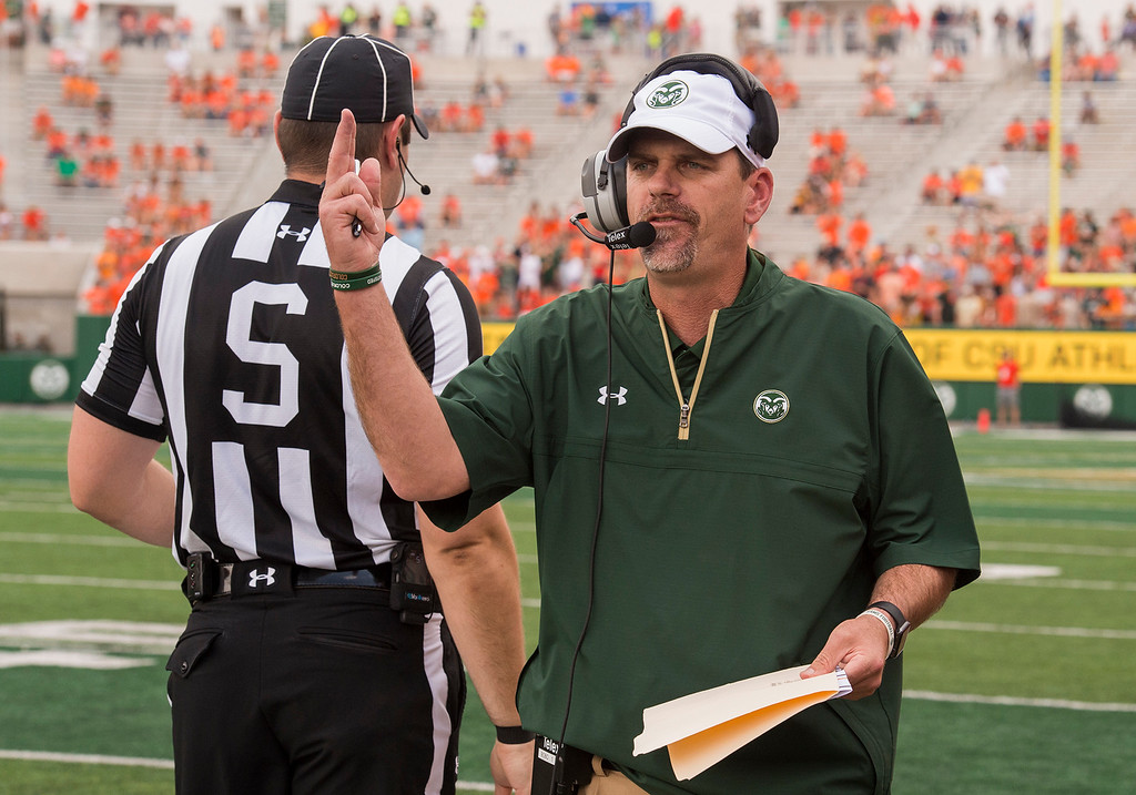 . Colorado State head football coach Mike Bobo talks on his headset after the team had trouble getting play calls into the offense against Abilene Christian University Saturday afternoon Sept. 9, 2017, at the CSU Stadium in Fort Collins. (Michael Brian/For the Reporter-Herald)