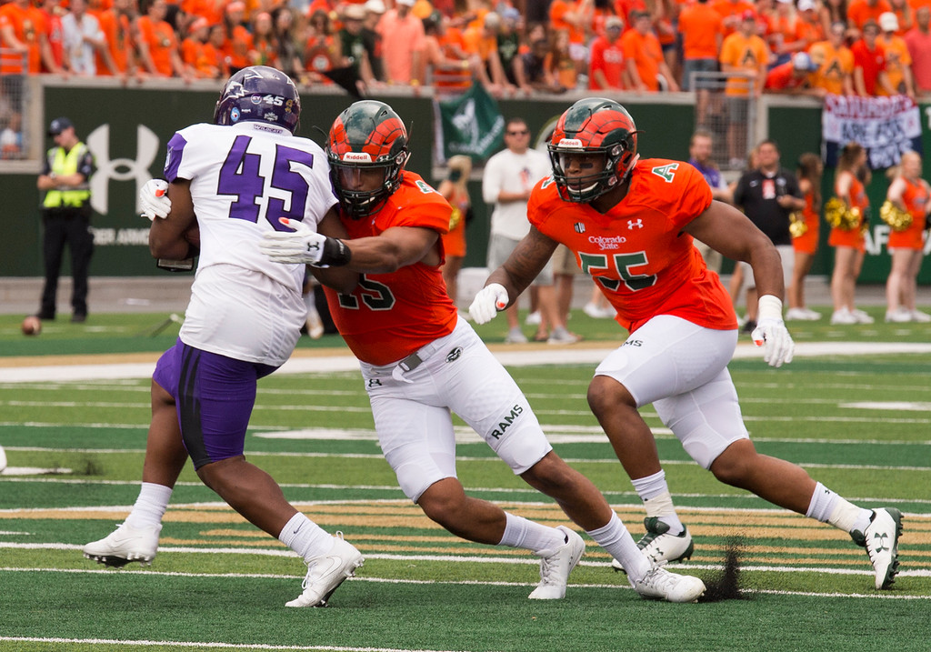 . Colorado State cornerback Dante Carnessale (45) gets his hands on Abilene Christian running back Qua\'Shawn Washington (45) during first-half action Saturday afternoon Sept. 9, 2017, at the CSU Stadium in Fort Collins. (Michael Brian/For the Reporter-Herald)