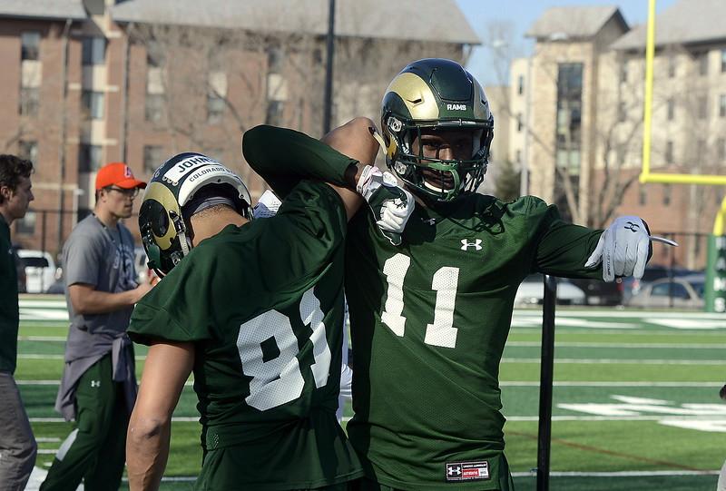 CSU receivers Bisi Johnson and Preston Williams clown around a bit during individual work during Wednesday's practice. (Mike Brohard/Reporter-Herald)