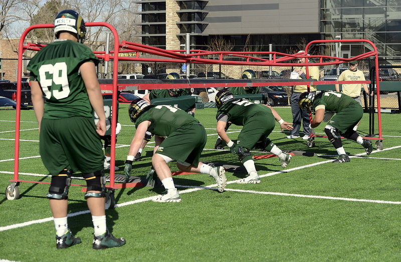 Colorado State's offensive linemen do individual work during Wednesday's practice, the second of spring camp. (Mike Brohard/Reporter-Herald)