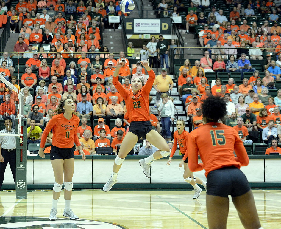 . Katie Oleksak leaps to set the ball during Friday\'s match between No. 25 Colorado State and No. 16 Michigan at Moby Arena in Fort Collins.