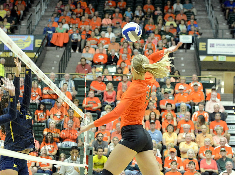 Colorado State middle blocker Alexandra Poletto reaches back on the attack during the No. 25 Rams' match Friday with No. 16 Michigan at Moby Arena in Fort Collins.