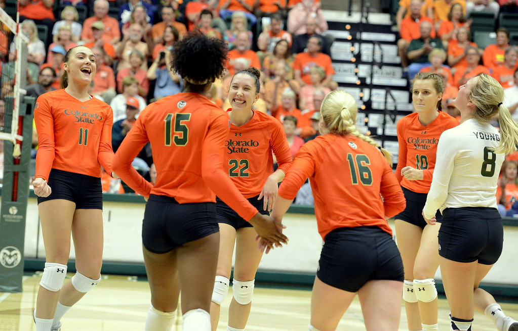 . Colorado State\'s players celebrate a point during Friday\'s match with No. 16 Michigan at Moby Arena in Fort Collins. The No. 25 Rams swept a ranked opponent for the second time in a week.