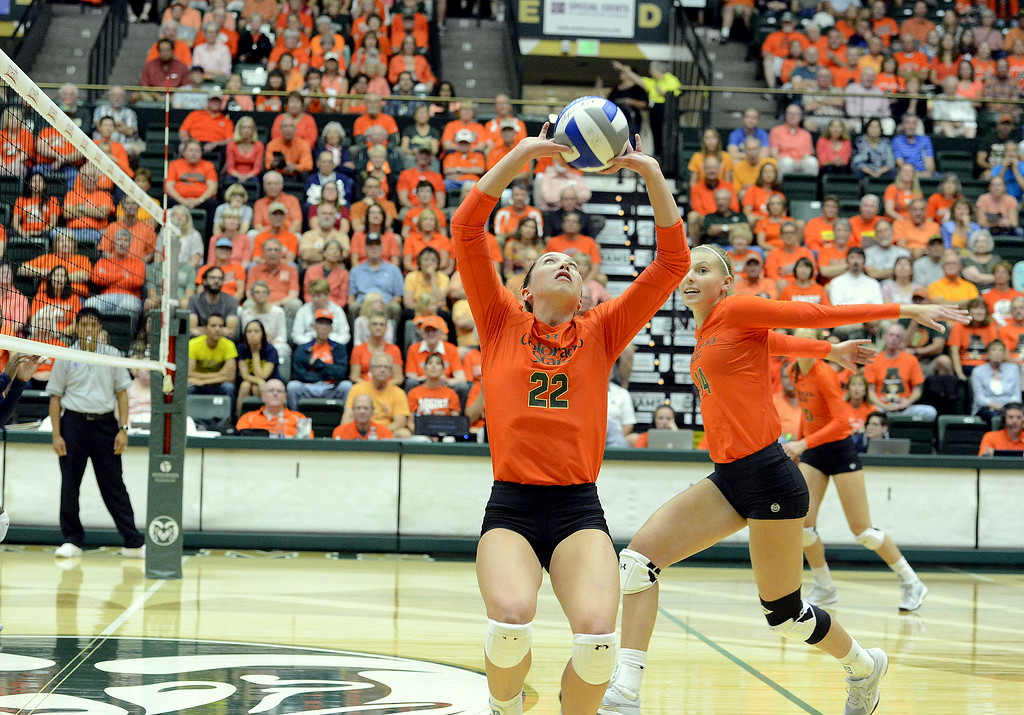. Colorado State\'s Alexandra Poletto moves in for the attack as setter Katie Oleksak delivers a pass Friday as the No. 25 Rams hosted No. 16 Michigan at Moby Arena in Fort Collins.