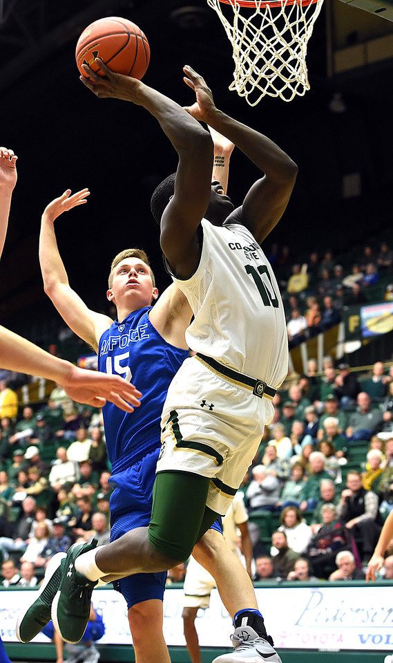 Colorado State University's (10) Che Bob goes up for a shot past Air Force's (15) Jacob Van during their game Wednesday, Jan. 17, 2018, at Moby Arena in Fort Collins. (Photo by Jenny Sparks/Loveland Reporter-Herald)