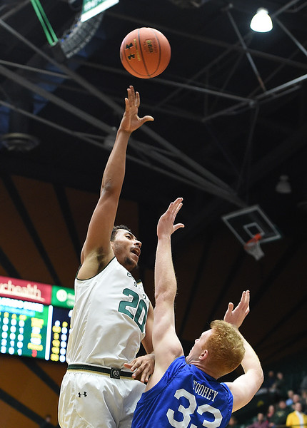 Colorado State University's (20) Deion James shoots as Air Force's (33) Frank Toohey tries to block during their game Wednesday, Jan. 17, 2018, at Moby Arena in Fort Collins. (Photo by Jenny Sparks/Loveland Reporter-Herald)