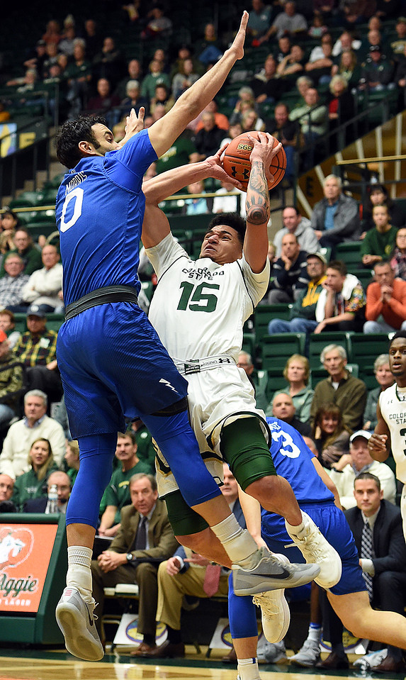 Colorado State University's (15) Anthony Bonner tries to get past Air Force's (0) Caleb Morris during their game Wednesday, Jan. 17, 2018, at Moby Arena in Fort Collins. (Photo by Jenny Sparks/Loveland Reporter-Herald)