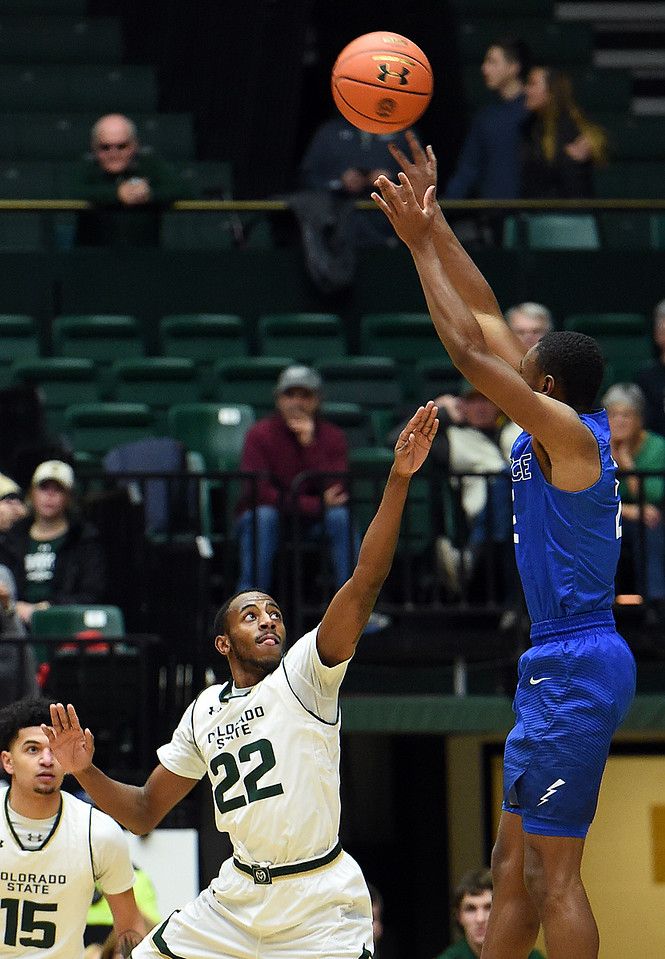 Colorado State University's (22) J.D. Paige tries to block Air Force's (20) Trevor Lyons during their game Wednesday, Jan. 17, 2018, at Moby Arena in Fort Collins. (Photo by Jenny Sparks/Loveland Reporter-Herald)