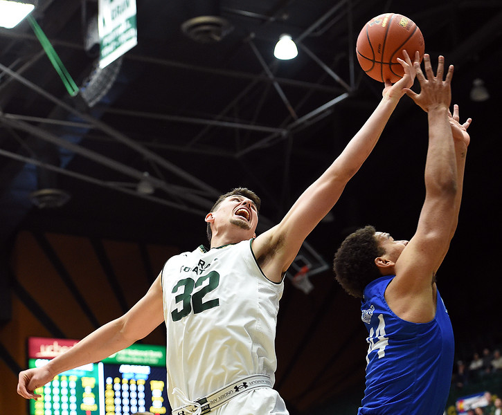 Colorado State University's (32) Nico Carvacho goes up for a shot past Air Force's (44) Keaton Van Soelen during their game Wednesday, Jan. 17, 2018, at Moby Arena in Fort Collins. (Photo by Jenny Sparks/Loveland Reporter-Herald)