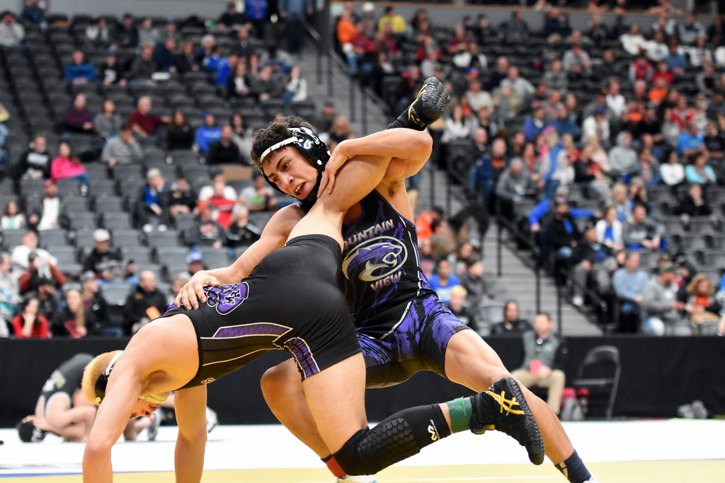 . Mountain View\'s Malachi Contreras, right, competes during the state wrestling tournament quarterfinals Friday Feb. 16, 2018 at the Pepsi Center in Denver. (Cris Tiller / Loveland Reporter-Herald)