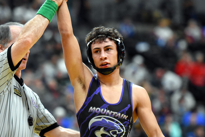 Mountain View's Malachi Conteras has his hand raised after winning his quarterfinal match during the state wrestling tournament quarterfinals Friday Feb. 16, 2018 at the Pepsi Center in Denver. (Cris Tiller / Loveland Reporter-Herald)