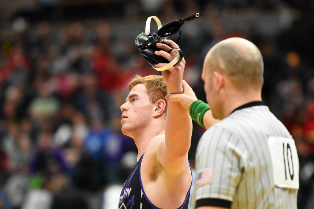 . Mountain View\'s Braden Barker has his arm raised after winning his semifinal match Friday Feb. 16, 2018 during the 4A state wrestling tournament at the Pepsi Center in Denver. (Cris Tiller / Loveland Reporter-Herald)