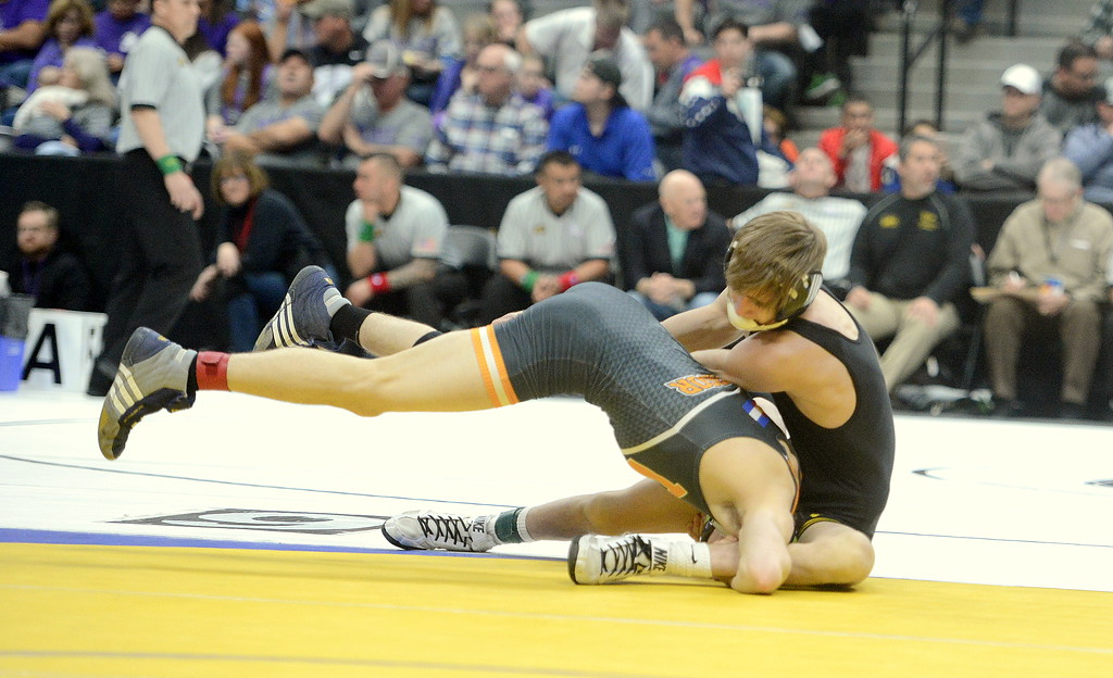 . Thompson Valley\'s Airiel Siegel tries to flip over Windsor\'s Will VonBour during their 113-pound semifinal match in the 4A state wrestling tournament Friday night at the Pepsi Center in Denver.