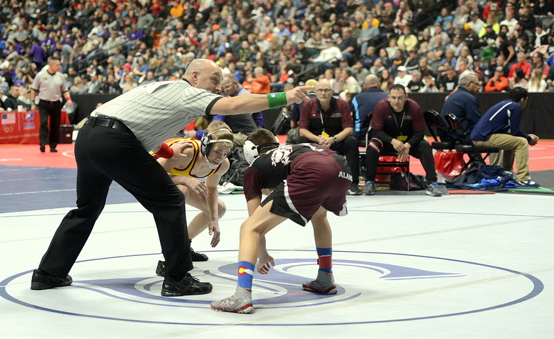 Berthoud's Dalton Williams is primed at the start of his 3A state tournament 106-pound semifinal match with Davion Chavez of Alamosa on Friday night at the Pepsi Center in Denver.