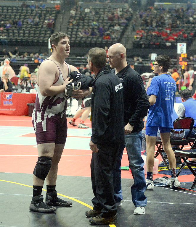 . Berthoud  heavyweight Connor Balliet talks to coaches Will Carron and Faren Stroh after dropping his quarterfinal match to top-seeded Logan Church of Delta on Friday at the 3A state tournament at the Pepsi Center in Denver.