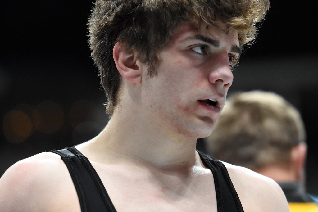 . Thompson Valley\'s Chase Engelhardt looks off the matt after losing during the state wrestling tournament quarterfinals Friday Feb. 16, 2018 at the Pepsi Center in Denver. (Cris Tiller / Loveland Reporter-Herald)