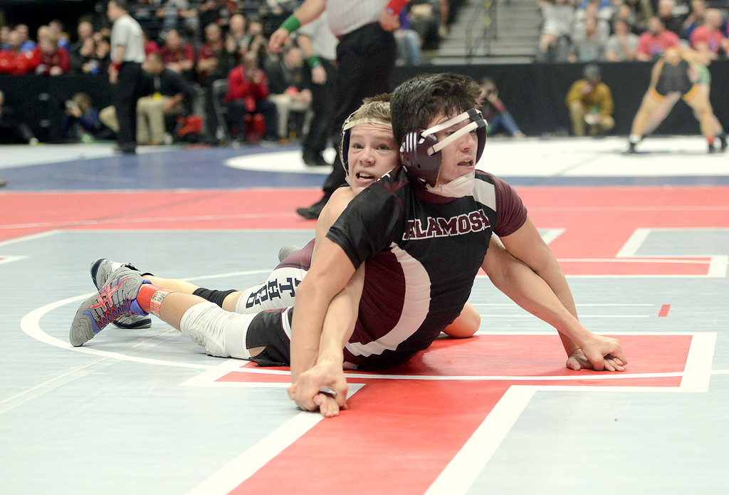 . Berthoud\'s Kolten Strait strains as he keeps control of Alamosa\'s Elijah DelaCerda in their 113-pound 3A semifinal match Friday night at the Pepsi Center. Strait reached the state final with a 5-0 decision.