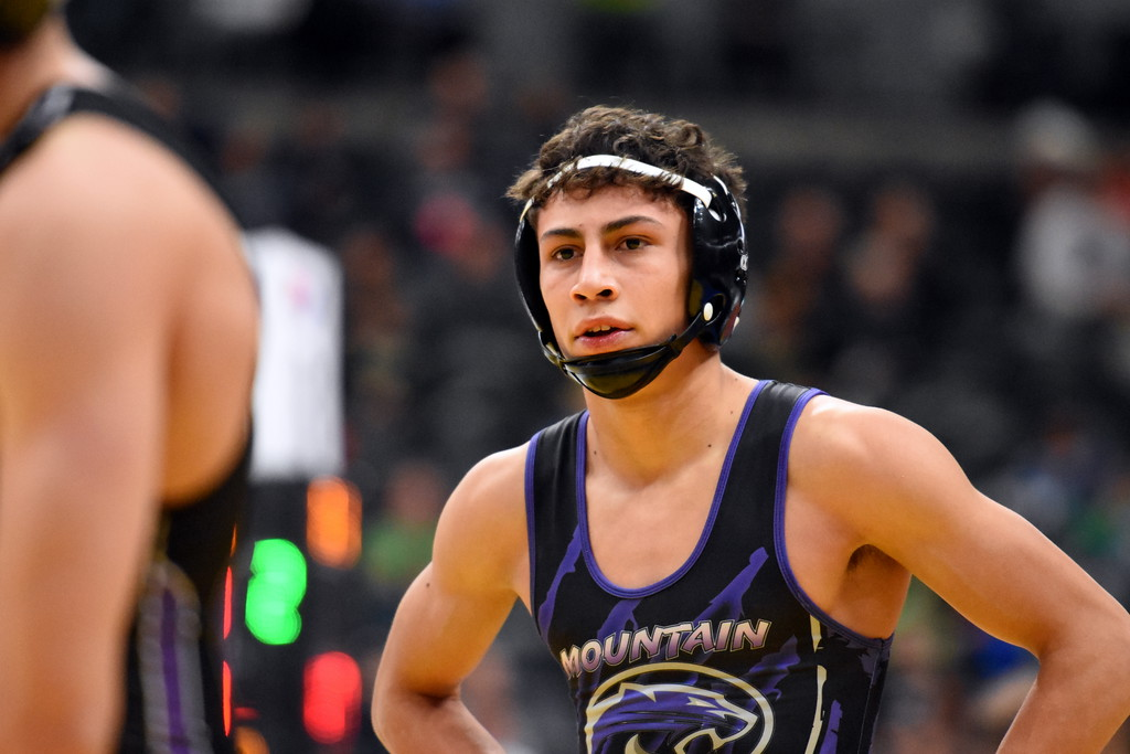. Mountain View\'s Malachi Contreras looks off to the crowd before his match during the state wrestling tournament quarterfinals Friday Feb. 16, 2018 at the Pepsi Center in Denver. (Cris Tiller / Loveland Reporter-Herald)