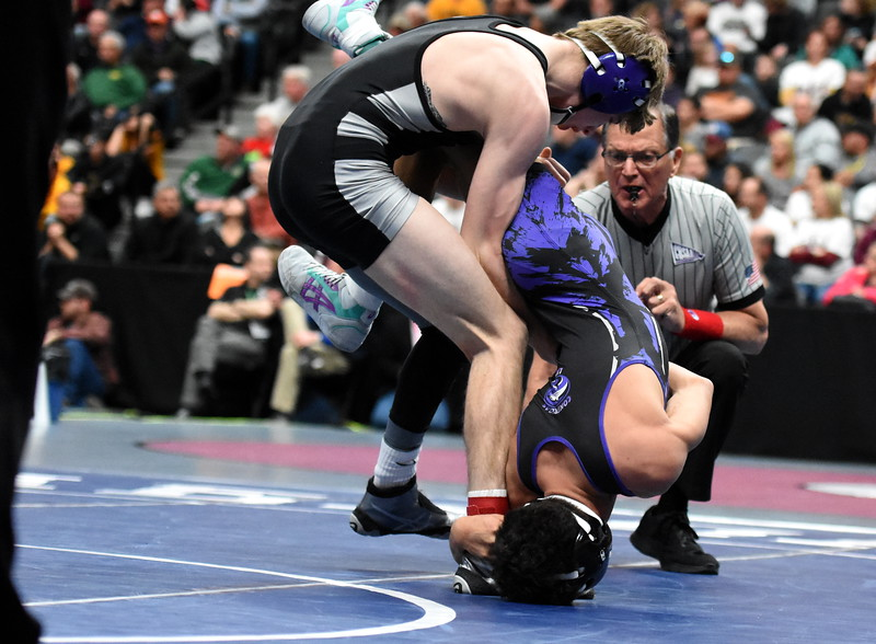Mountain View's Malachi Contreras is taken down in his semifinal loss Friday Feb. 16, 2018 during the 4A state wrestling tournament at the Pepsi Center in Denver. (Cris Tiller / Loveland Reporter-Herald)