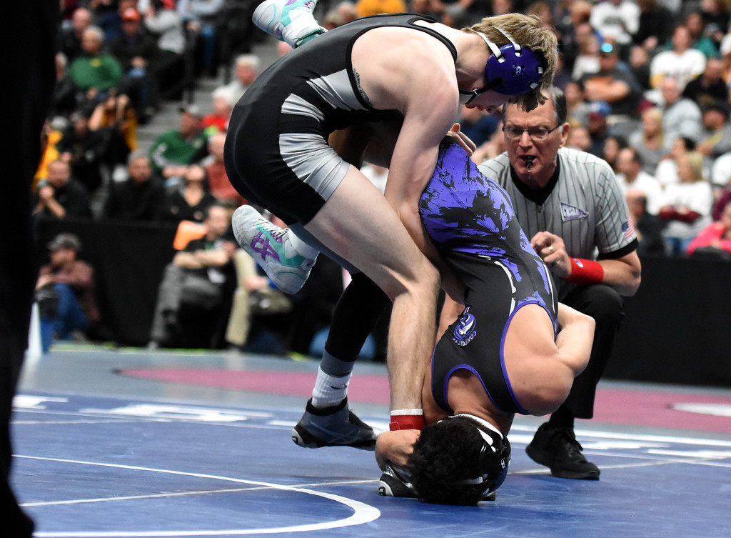. Mountain View\'s Malachi Contreras is taken down in his semifinal loss Friday Feb. 16, 2018 during the 4A state wrestling tournament at the Pepsi Center in Denver. (Cris Tiller / Loveland Reporter-Herald)
