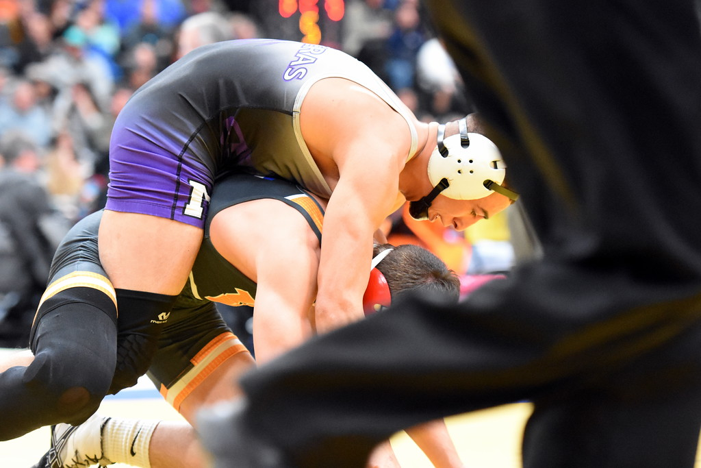 . Mountain View\'s Erik Contreras rides his opponent during the state wrestling tournament quarterfinals Friday Feb. 16, 2018 at the Pepsi Center in Denver. (Cris Tiller / Loveland Reporter-Herald)