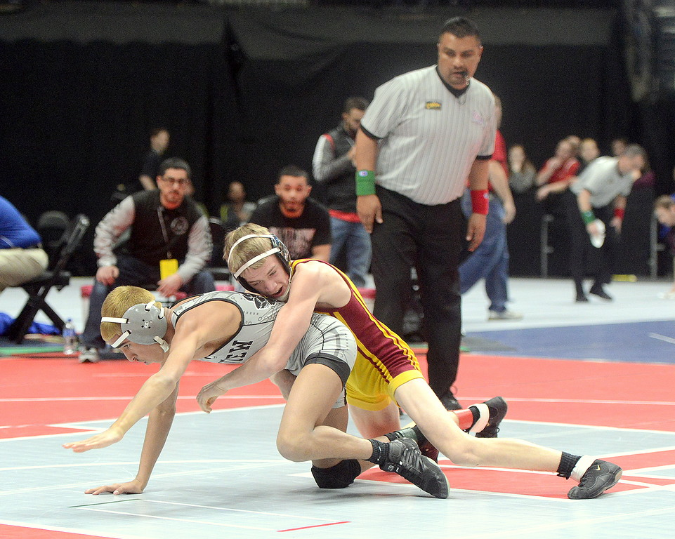 . Berthoud\'s Dalton Williams gets a takedown agaisnt Nadim Karger of Skyview in his 106-pound quarterfinal match of the 3A state wrestling tournament at the Pepsi Center in Denver. Williams advanced to the semifinals with a pin in 53 seconds.