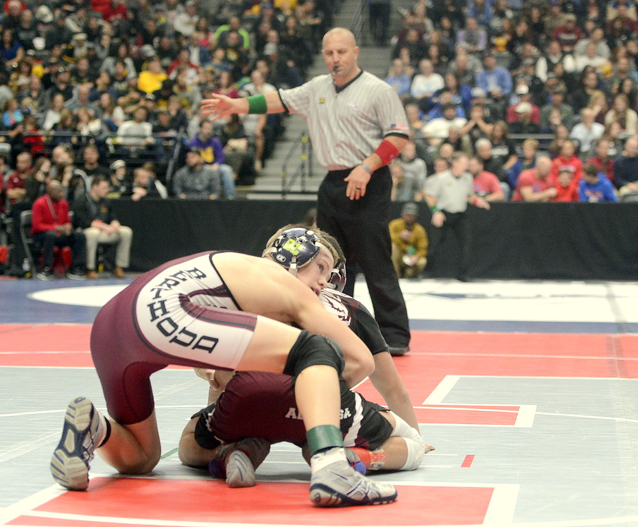 . Berthoud\'s Kolten Strait settles into the top position in his 113-pound semifinal in the 3A state wrestling tournament Friday at the Pepsi Center in Denver. Strait won the match 5-0.