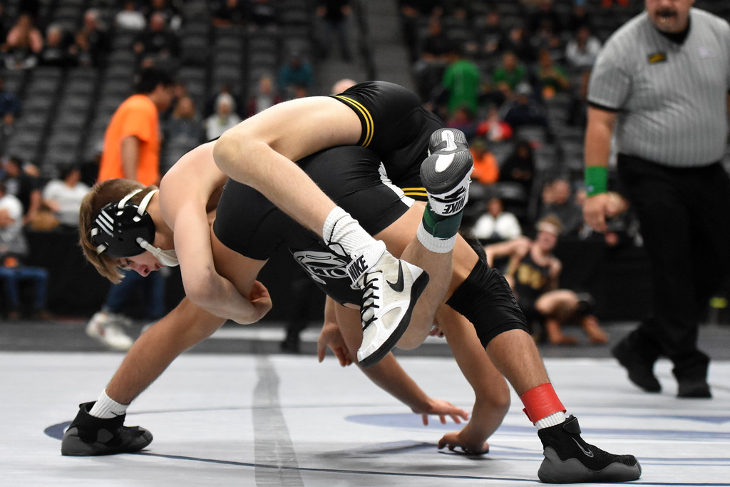 . Thompson Valley\'s Airiel Siegel goes for a cradle during his 113-pound match at the state wrestling tournament quarterfinals on Friday Feb. 16, 2018 at the Pepsi Center in Denver. (Cris Tiller / Loveland Reporter-Herald)