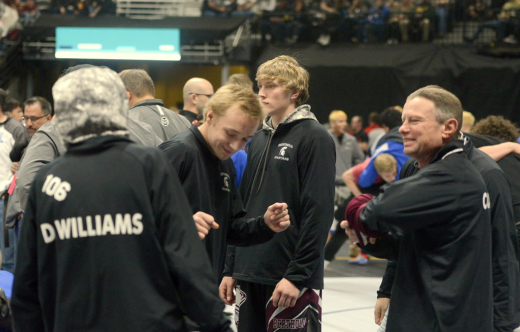 . Berthoud\'s Austyn Binkly breaks out his dance moves during warmups prior to the start of Friday\'s semifinal round at the state wrestling tournament.