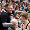 Thompson Valley's Hunter Williams, right, is congratulated by his dad Chad Williams on Friday Feb. 16, 2018 during the 4A state wrestling tournament at the Pepsi Center in Denver. (Cris Tiller / Loveland Reporter-Herald)