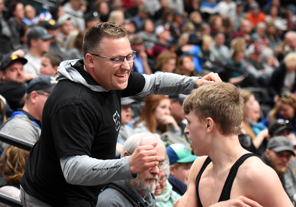 . Thompson Valley\'s Hunter Williams, right, is congratulated by his dad Chad Williams on Friday Feb. 16, 2018 during the 4A state wrestling tournament at the Pepsi Center in Denver. (Cris Tiller / Loveland Reporter-Herald)