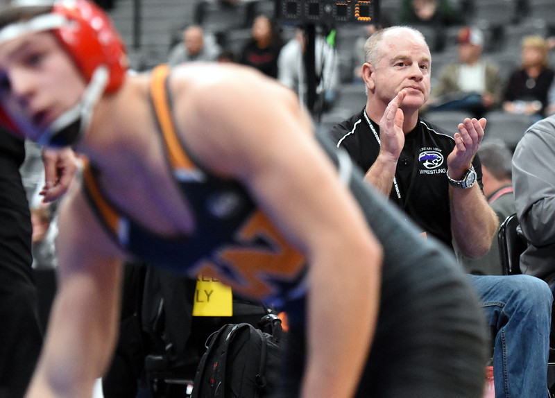Mountain View coach Scott Barker claps during the state wrestling tournament quarterfinals Friday Feb. 16, 2018 at the Pepsi Center in Denver. (Cris Tiller / Loveland Reporter-Herald)