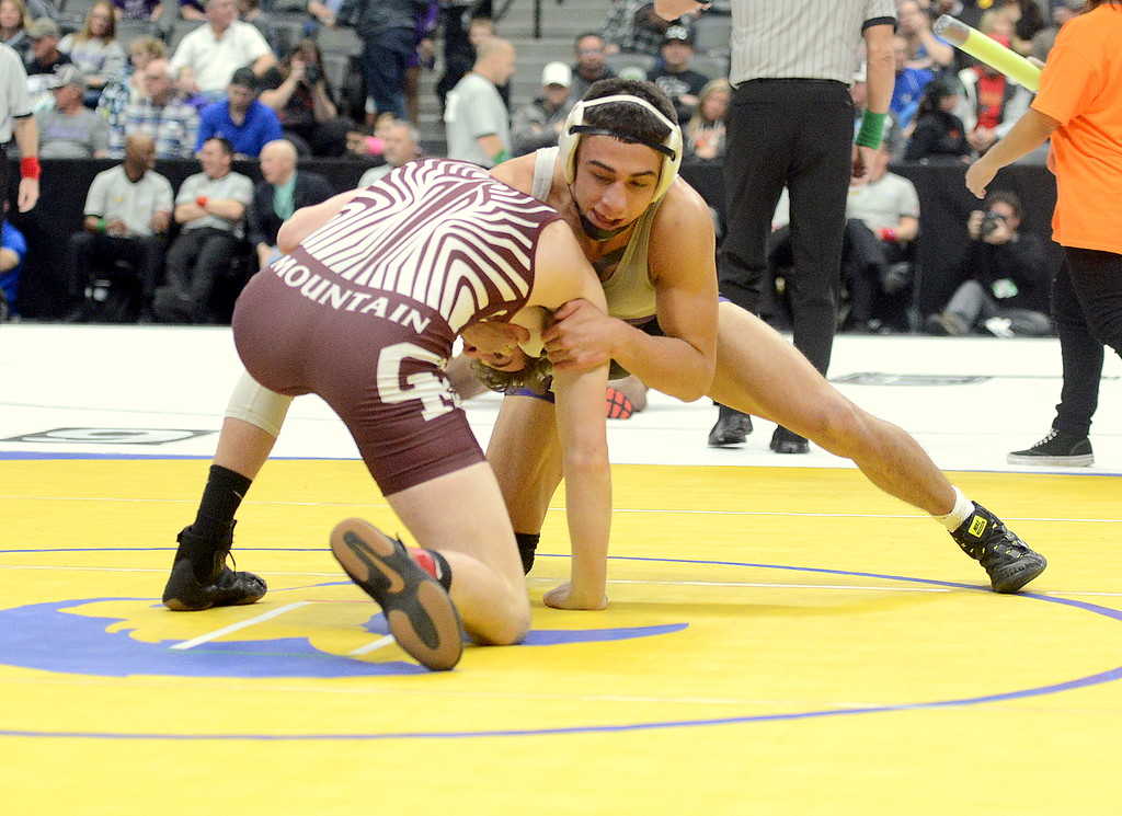 . Erik Contreras of Mountain View ties up with Cheyenne Mountain\'s Mike McFarren during their 4A semifinal match at 138 pounds during the state wrestling tournament at the Pepsi Center in Denver.