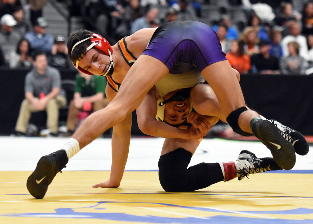 . Mountain View\'s Erik Contreras tries to elude a move during the state wrestling tournament quarterfinals Friday Feb. 16, 2018 at the Pepsi Center in Denver. (Cris Tiller / Loveland Reporter-Herald)