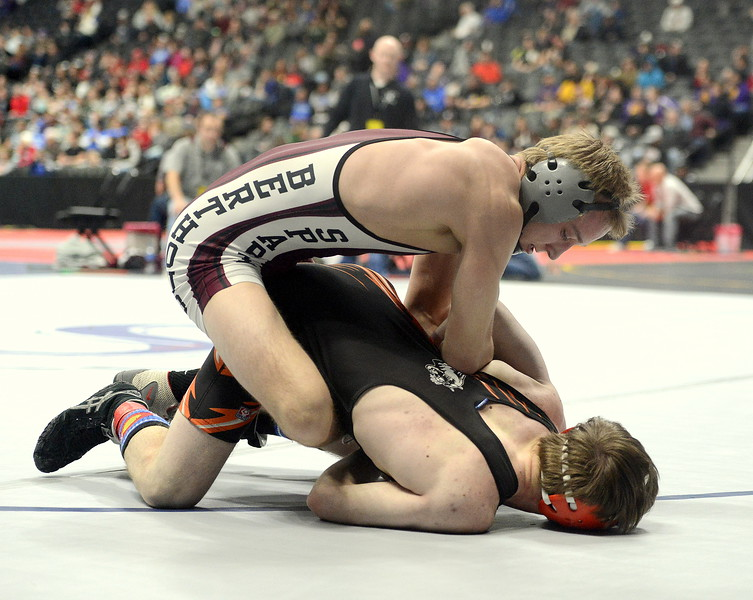 Top-seeded Austyn Binkly of Berthoud tries to dig out the arm of Matthew Broughton of Montezuma-Cortez in their 138-pound quarterfinal match at the 3A state wrestling tournament Friday at the Pepsi Center in Denver. Binkly advanced with an 8-3 decision.