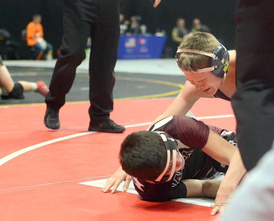 . The emotions of reaching the state finals hit Berthoud\'s Kolten Strait at the end of his 5-0 victory over Alamosa\'s Elijah DeLaCerda in their 113-pound semifinal match of the 3A state wrestling tournament Friday at the Pepsi Center in Denver.