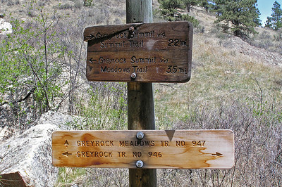 "After half a mile or less, you reach the ""split"" in the trail.  To the left is the meadow trail, to the right the trail heads up a canyon.  The bottom sign is a little confusing.  The top sign is more straightforward and accurate."