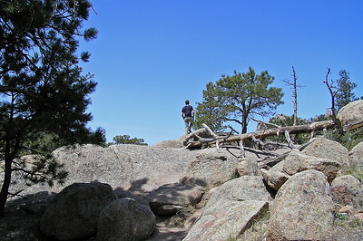 "Eventually we came upon a ""lookout"" that provided some good view.  Here is Will looking out from the top."